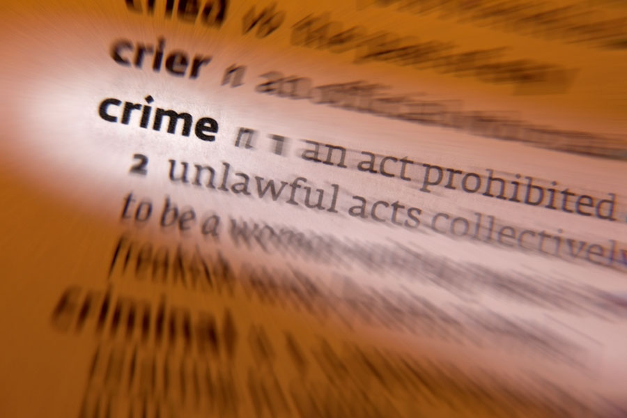 Image of blurred dictionary page with the word crime highlighted.