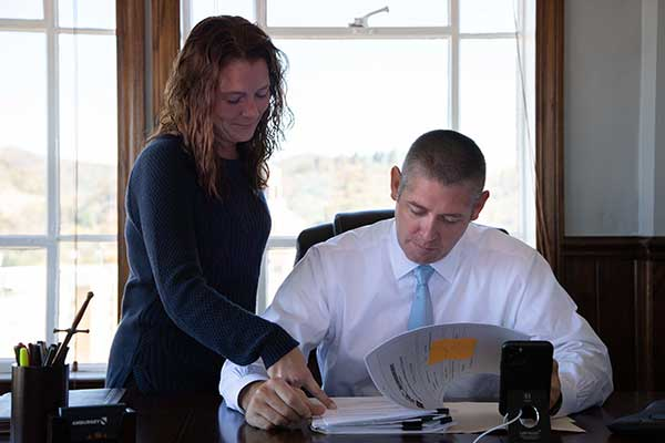 Asheville Criminal Defense Lawyer, Thomas Amburgey, with Paralegal, Vanessa Sprouse, working on a client file at Thomas's downtown office